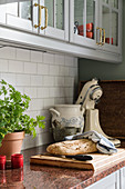 Granite worksurface, grey cabinets and subway tiles in kitchen