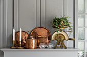 Copper items and kitchen scales on grey shelf