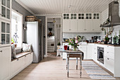 Antique drop-leaf table in classic, country-house-style kitchen