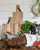 Bread, wooden boards and basic on kitchen worksurface