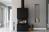 Wood-burning stove against grey wall