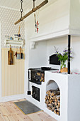 Wood-burning stove in kitchen