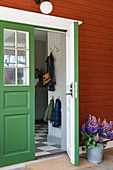 Falu-red wooden house with green front door