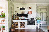 Old wood-fired stove and oven in country-house kitchen