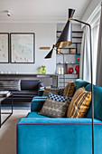 Blue custom sofa and standard lamp in living room