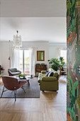 Green leather sofa in open-plan classic living room