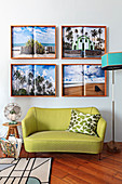 Four holiday photographs above small, green, retro sofa in living room