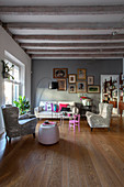 Classic mixture of styles in living room with wooden floor and wood-beamed ceiling