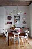 Antique chandelier above wooden table in dining room