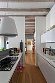 Gas hob in modern kitchen in rustic, open-plan interior