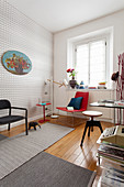 Graphic wallpaper and various chairs in study