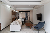 Fitted kitchen, living area and skylights in open-plan interior
