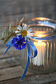 Lantern with marguerite, cornflower and oats