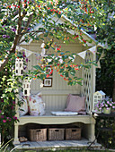 Cozy little garden bench with a crabapple tree in the foreground