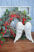 Angel wings and autumn wreath of teaberries