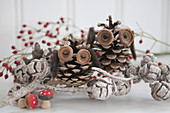 Owls handcrafted from pinecones and acorn cups decorated with waxed pine cones and miniature fly agarics