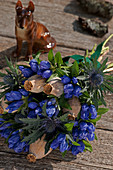 Closed Gentiana with Eryngo and poppy pods tied to a bouquet