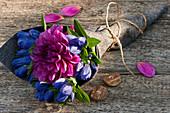 Closed gentian with dahlia blossom made into a bouquet