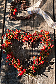 Heart wreath made of rose hips and twigs