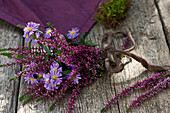 A small bouquet of budding heather and autumn aster