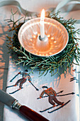 Small bundt cake pan as a candle holder in a wreath made from Arizona cypress