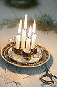 Stylized Advent wreath with 4 candles in a cookie cutter