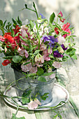 Bouquet of sweet peas in a zinc pot
