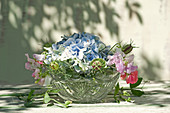 Bouquet of hydrangea, sweet peas and love-in-a-mist