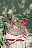 Sweet pea flowers in bowl