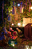 Fairy lights in romantic ivy-covered arbour at twilight