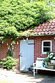 Roof of outbuilding covered with ivy