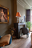 Gilt-framed painting, wine rack and cast iron stove in bedroom