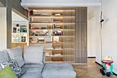 Grey sofa set in front of oak bookcase