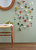 Various flowers stuck on wall with masking tape