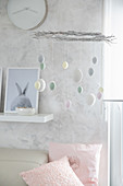 DIY Easter mobile decorated with pastel-coloured eggs