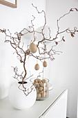 Twig decorated with papier-mâché eggs