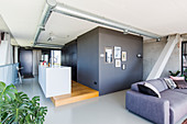 Kitchen island and grey sofa in loft apartment