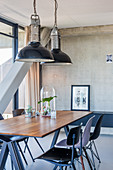 Industrial lamps above dining table in loft apartment