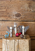 Angels handmade from pieces of wood, beads and feathers