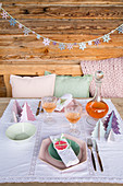 Festively set table decorated with handmade decorations in pastel shades