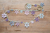 Handmade garland of paper snowflakes