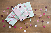 Wrapped gifts and handmade paper garland