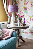 Roses and table lamp on round side table