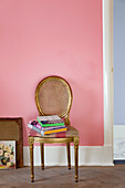 Gilded medallion chair against pink wall