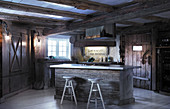 Island counter in rustic kitchen in old wooden house