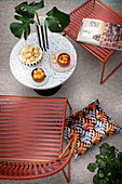 Outdoor armchair and table on PVC carpet on the terrace