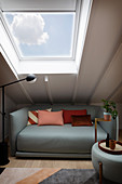 Light gray sofa and matching coffee table under the roof