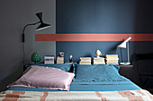 Double bed in the bedroom with a dark wall