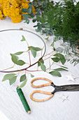 Eucalyptus, yarrow, asparagus fern and metal ring