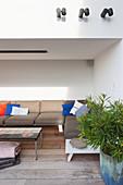 Corner sofa on roofed loggia on terrace